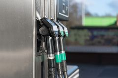 Fuel pump filling nozzles for petrol and diesel at a gasoline st. Ation, copy space, selected focus royalty free stock photo