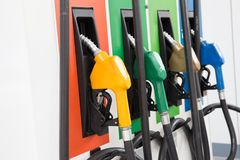 Fuel Pump, Gas Station, Gasoline.Colorful Petrol pump filling nozzles on white background. Gas station in a service in warm sunset.Head fuel vehicle refueling stock photos
