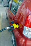 Fuel pump hand in a car Stock Images