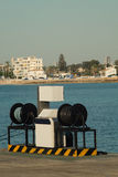 Fuel pump at a harbor. Fuel pump for vessels on a fishing harbor pier Stock Photos