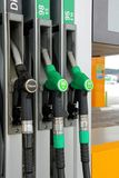 Fuel Pump Nozzles at Filling Station Royalty Free Stock Photos