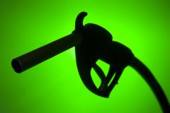 Free Fuel Pump Silhouette Against A Green Background Royalty Free Stock Photos - 7756708