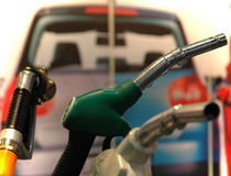 Fuel pumps. Gasoline pumps. A car in the background Stock Images