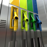 Fuel pumps. 3D rendering of four brightly colored gas pumps Royalty Free Stock Images