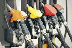Fuel pumps at gas station. Equipment fueling fuel stock images