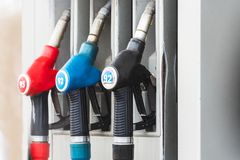 Fuel pumps at petrol station. Pistols on a gas station royalty free stock images