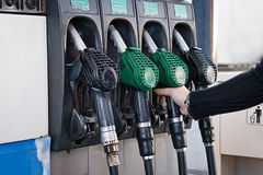 Fuel station. Woman in a fuel station royalty free stock photos