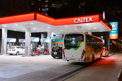 Fuel station at evening. HONG KONG - APRIL 15, 2015: Caltex fuel station at evening. Caltex is a petroleum brand name of Chevron Corporation used in more than royalty free stock photo