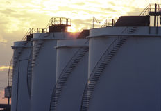 Fuel Storage Containers. At sunset Stock Images