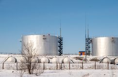 Fuel storage tanks in the protected area in winter Stock Image