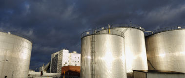 Fuel storage tanks at sunset Stock Photography