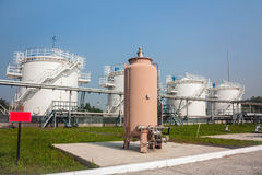 Fuel store tanks of refueling complex. In the airport stock photos