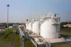 Fuel store tanks of refueling complex. In the airport stock photo