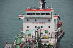 Fuel supplier in detail. Navigating in port Stock Images