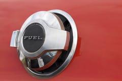 Fuel tank cap. Close up shot of fuel tank cap on red car Royalty Free Stock Photos