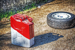 Fuel tank and car wheel on the ground Royalty Free Stock Photography