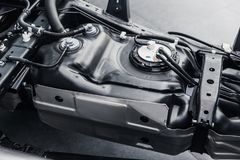 Fuel tank inside car chassis underbody. Clean new from factory Stock Photo