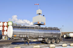 Fuel Tanker Truck. In front of container warehouse Stock Photos