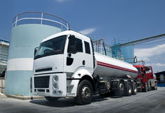 Fuel tanker. Truck loading front of the silo Royalty Free Stock Image