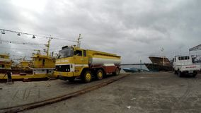 Fuel tanker truck parked at fishing port harbor. Dalahican, Lucena City, Philippines - December 29, 2017: Fuel tanker truck parked at fishing port harbor stock video footage