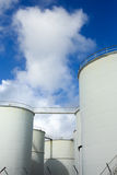 Fuel tanks. Industrial white Fuel Tanks and blue sky with clouds Royalty Free Stock Photo