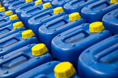 Fuel Tanks. Many Blue Fuel Tanks With Yellow Caps royalty free stock photos