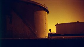 Fuel Tanks. Fuel (oil) tanks, photographed using the 'redscale' process, for a grainy, low fidelity post-apocalypse look Royalty Free Stock Photo