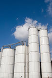Fuel Tanks. Factory fuel storage tanks with copyspace in sky background Stock Photography