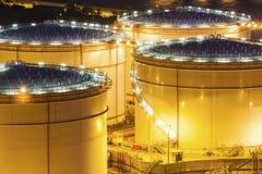Fuel tanks at night Stock Photos