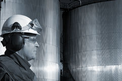 Fuel tanks and oil worker Stock Photos