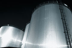 Fuel tanks refinery at dusk Stock Images