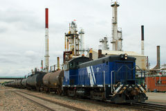 Fuel Train. This is a train hauling oil cars past a refinery Stock Images