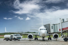Fuel truck filling aviation fuel for plane Stock Image