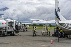 Free Fuel Truck Refueling Small Propeller Airplane Before Takeoff At Arusha Airport, Tanzania, East Africa Royalty Free Stock Photography - 182671087