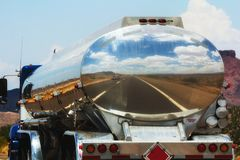 Fuel truck on the road. The road is reflecting in the fuel tanker of a truck Royalty Free Stock Photos