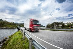 Fuel truck rushes down the highway, Norwey. Truck Car in motion Stock Images