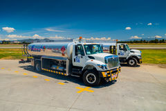 Fuel trucks parked in front of aircraft at Stock Image