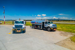 Fuel trucks parked in front of aircraft at Stock Images