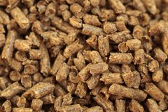 Fuel wood pellet close-up. A source of alternative clean energy. A lot of pellet. Natural fuel and energy of future stock photo