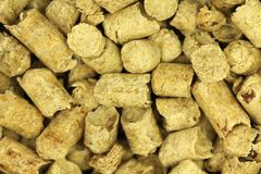 Fuel wood pellets background. Fuel wood pellets abstract background Royalty Free Stock Images