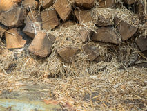 The fuel wood stacked on top of each other mixed with straw. Boards of pine, view of the end. Firewood for heating the. House and kindling. Wood for the stove royalty free stock images