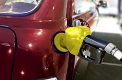 Fueling car with petrol at pump station Stock Photo