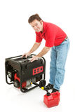 Fueling the Generator. Man preparing to put gas in his portable emergency generator. Isolated on white Stock Images