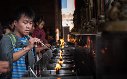 Fueling lamp at Wat Yai Chai Mongkol. The Fueling lamp was filled deeds to light a fire before time Stock Photo