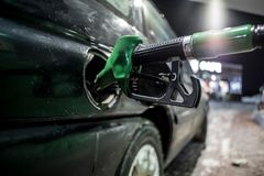Fueling nozzles at filling station stock images