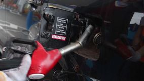 Fueling station service man glove pulls out pistol car gas. Stock footage stock video