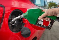 Fuelling. Male hand refilling automobile fuel Royalty Free Stock Image