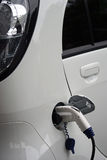 Fuelling an electrical car. Fuelling an electrical car, power plug Royalty Free Stock Photos