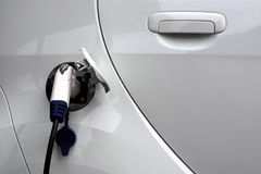 Fuelling an electrical car. Fuelling an electrical car, power plug Stock Image