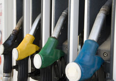 Fuelling nozzle. S on gasoline filling station Royalty Free Stock Photo